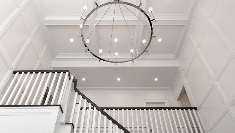 Hamptons Style Coffered Ceiling and Wall Treatment White Entry Stair