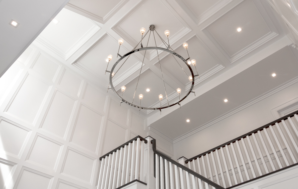Bright Entry Coffered Ceiling with White Stair Detail