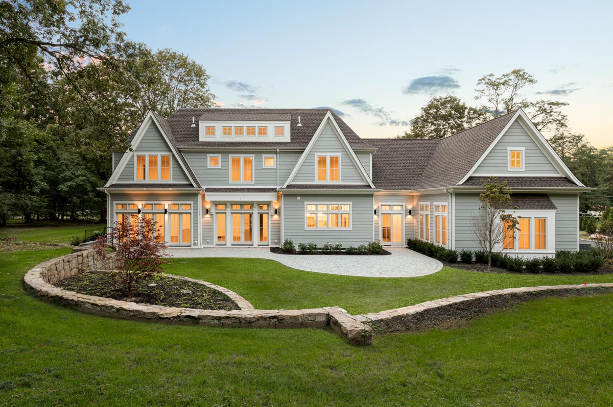Long Island Custom Home Architecture Rear Yard Elevation at Dusk